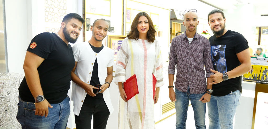 Saad Al Amiri, Reem Erhama and photographers at Al Haramain Perfumes Seef Mall Bahrain